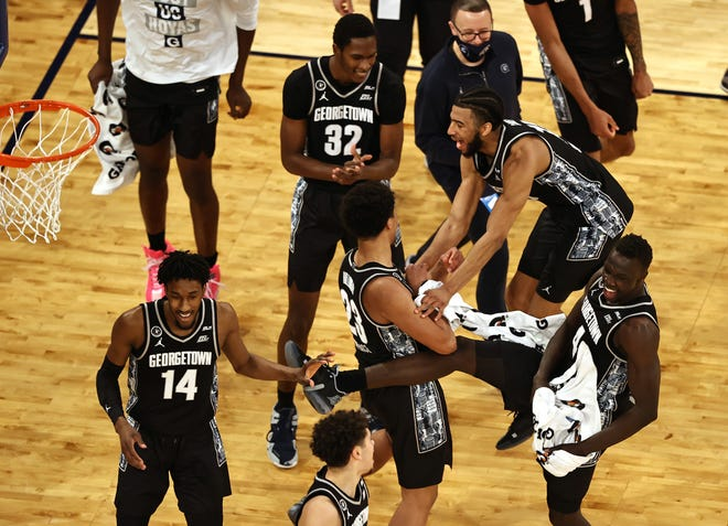 The Georgetown Hoyas celebrate the win of the Big East Championship game at Madison Square Garden on March 13, 2021 in New York City.The Georgetown Hoyas defeated the Creighton Bluejays 73-48 to win the title.