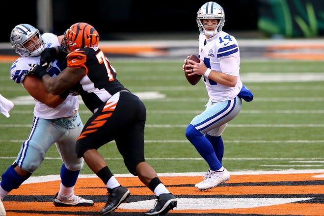 Dallas Cowboys quarterback Andy Dalton (14) drops back to pass in the third quarter of a Week 14 NFL football game against the Cincinnati Bengals, Sunday, Dec. 13, 2020, at Paul Brown Stadium in Cincinnati. The Dallas Cowboys won, 30-7.