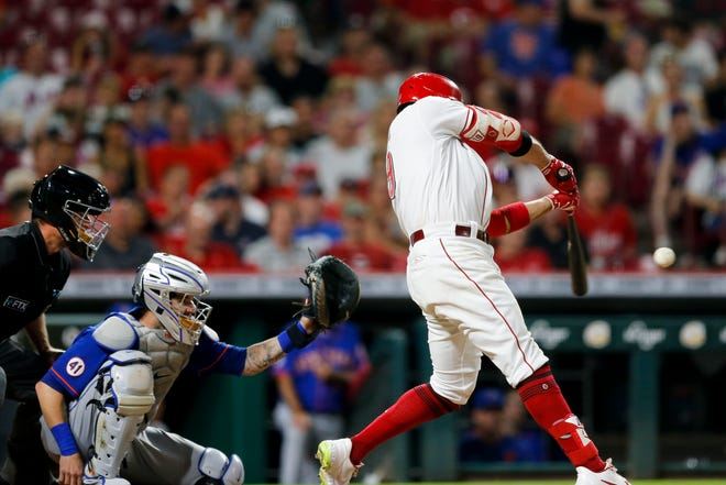 Cincinnati Reds first baseman Joey Votto (19) hits a double in the sixth inning of a baseball game against the New York Mets, Monday, July 19, 2021 at Great American Ball Park in Cincinnati.