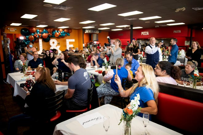 Friends and family attend the wedding of Eliza Wilde and Jon Kenyon at Cicis Pizza in Florence, Ky. on Monday, October 11, 2021.