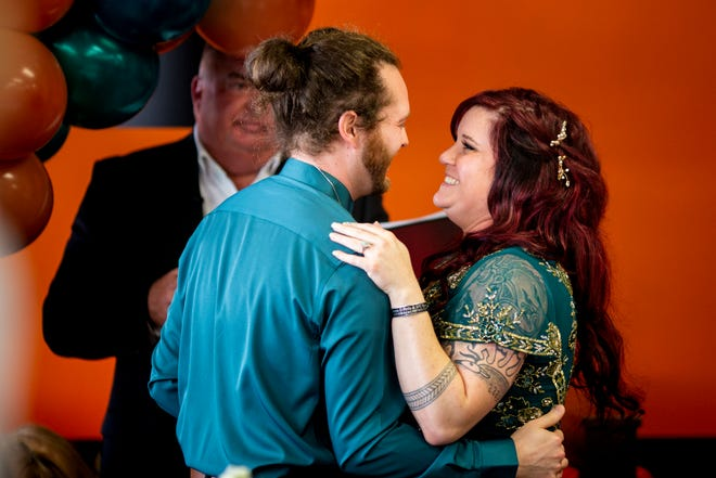 Eliza Wilde and Jon Kenyon embrace after getting married at Cicis Pizza in Florence, Ky. on Monday, October 11, 2021.