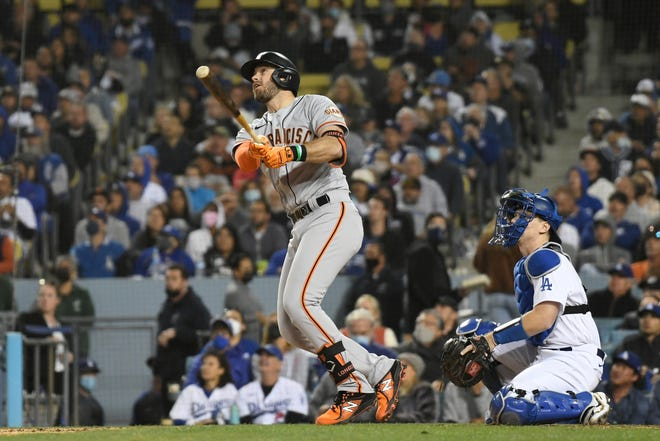 Evan Longoria hits a solo home run off Max Scherzer in the fifth inning to give the Giants a 1-0 lead.