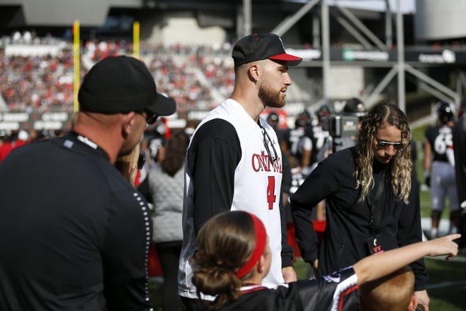 Former Bearcats tight end Travis Kelce walks on the sidelines before the first quarter of the NCAA American Athletic Conference game between the Cincinnati Bearcats and the Tulsa Golden Hurricane ay Nippert Stadium on Saturday, Oct. 19, 2019.